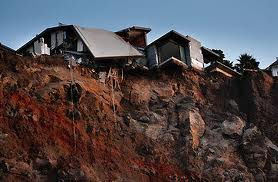 New Zealand's government to buy quake damaged houses